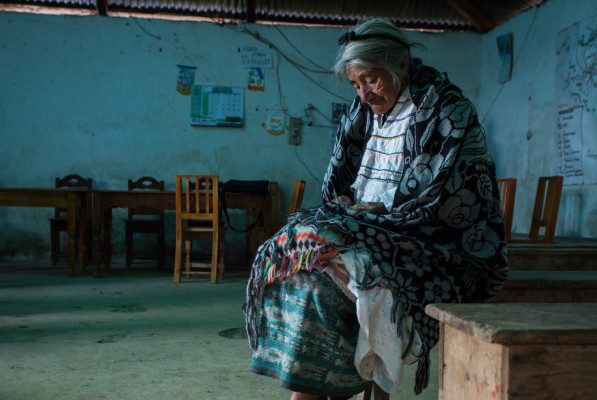 A woman sits in a comunal building in Santa Eulalia, Huehuetenango – March 2015