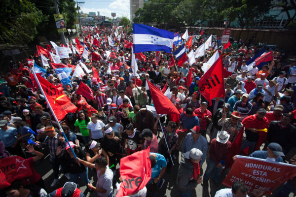Tens of thousands gather to denounce the alleged fraud in the 2017 election December 2017 – Appeared in The Progressive