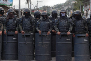 Soldiers line up to repress protesters in Villanueva December 2017 – Appeared on Waging Nonviolence